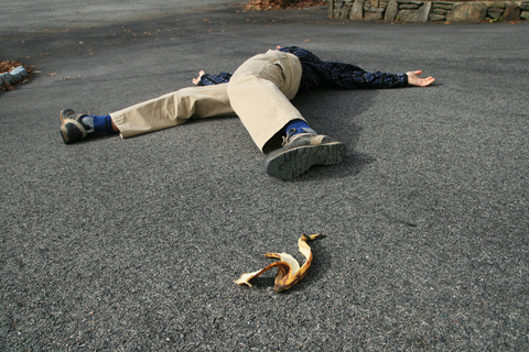 Man fell down after slipping on a banana peel