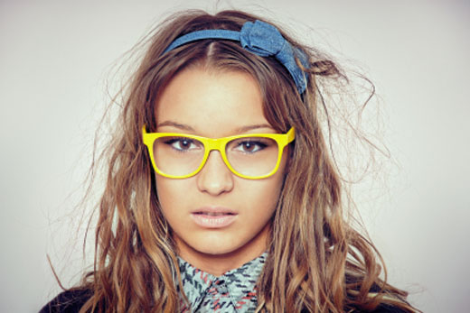 Pretty nerd girl with bright yellow glasses