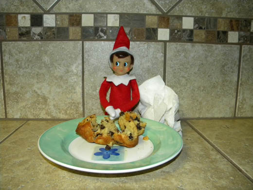 Elf on the Shelf eating a muffin
